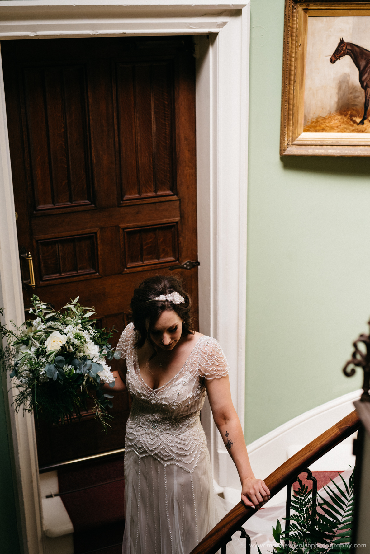 Bride walks down the stairs a story telling moment