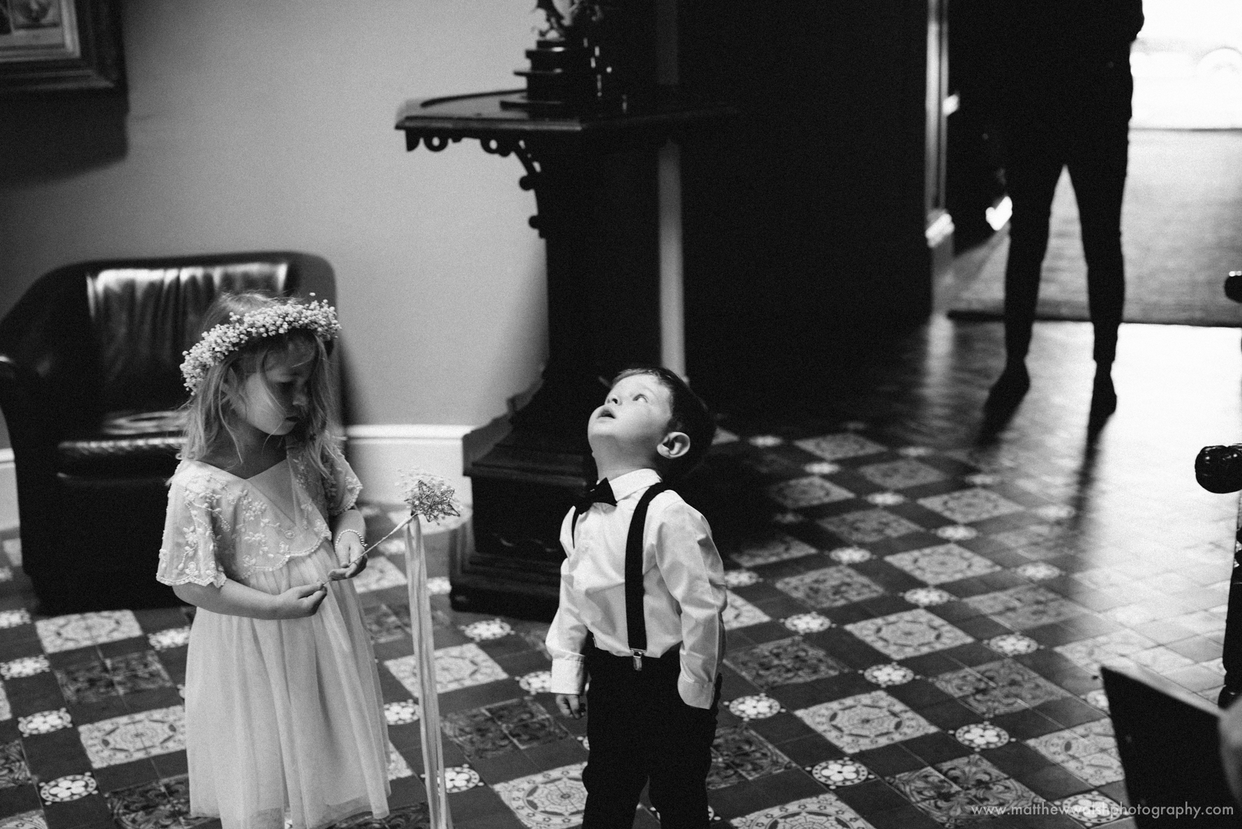 Page boy and flower girl watch the bride