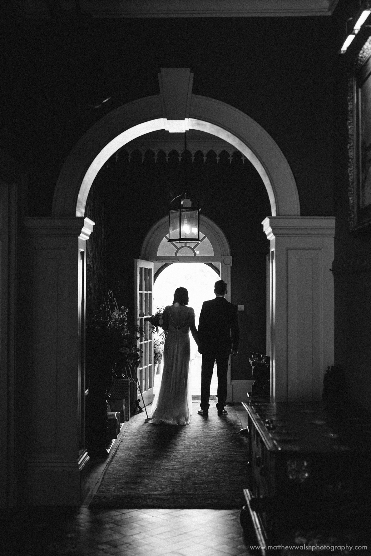 The happy couple prepare to exit the building perfect front lighting and silhouette