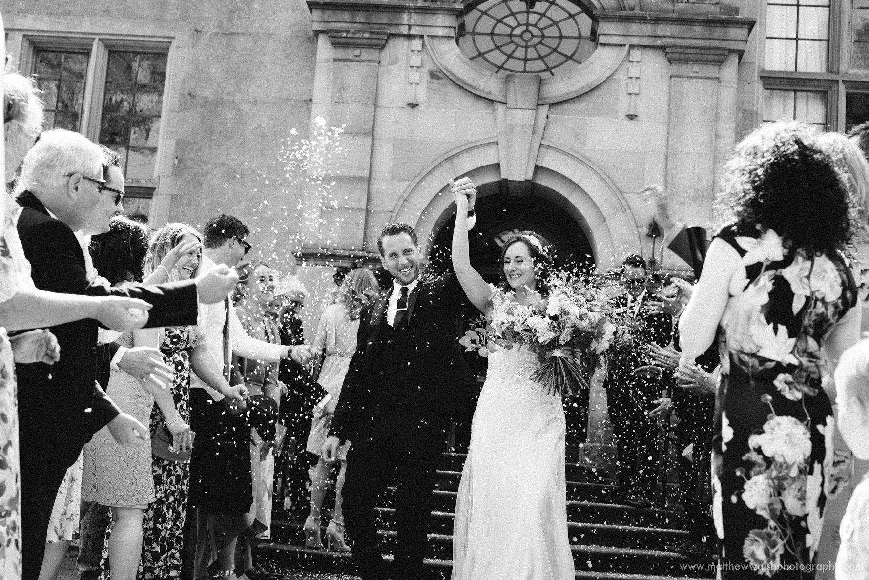 Confetti shot has the happy couple and guests cheer