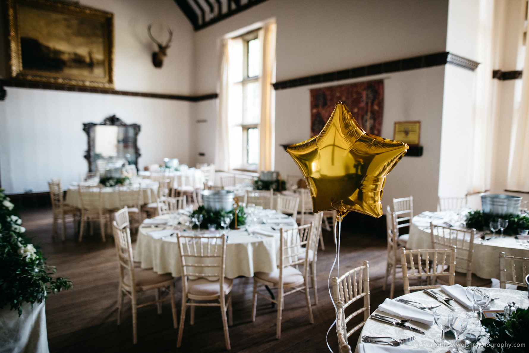 A gold balloon sits in the Edwardian grand hall