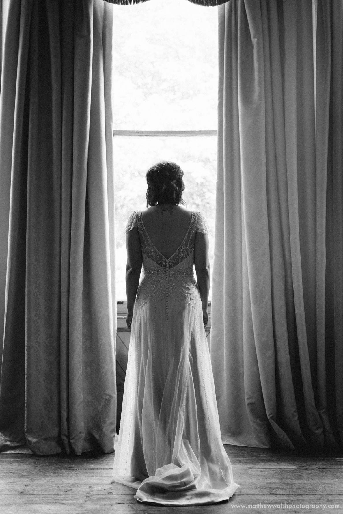 A detailed look at the back of the brides dress