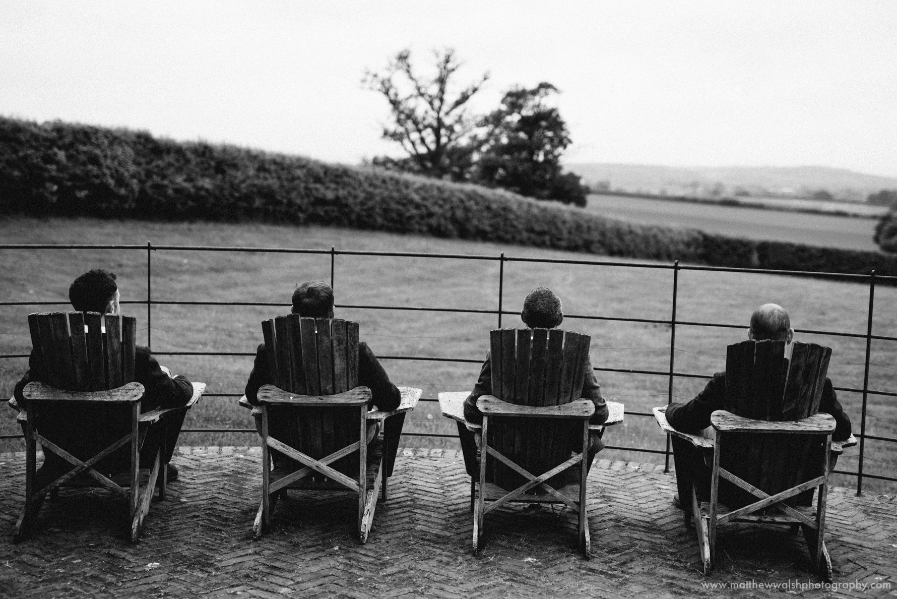 Groomsmen looking out over the Herefordshire landscape towards the black mountains