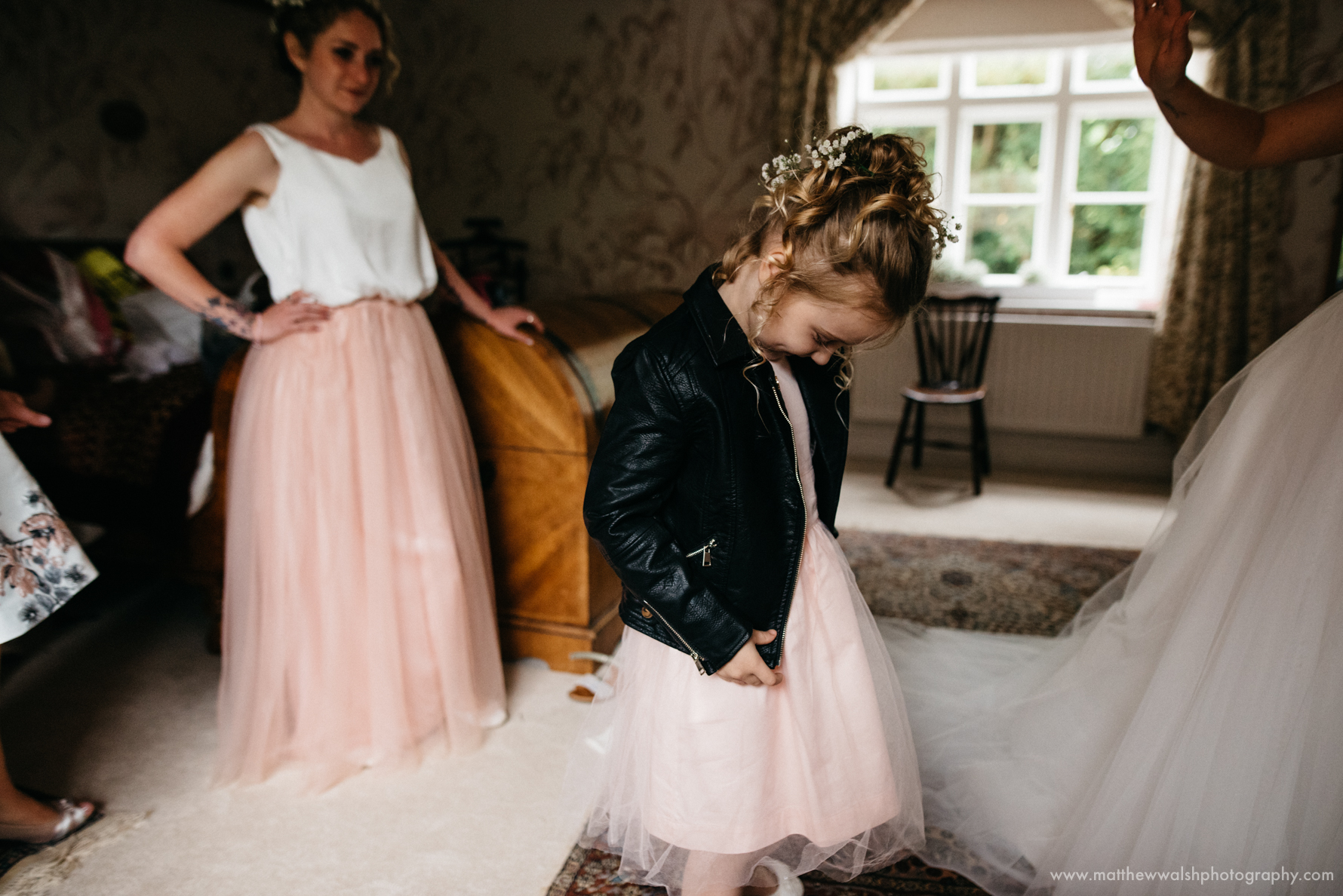 Flower girl wearing a super stylish leather jacket, ready for any weather the day may give.