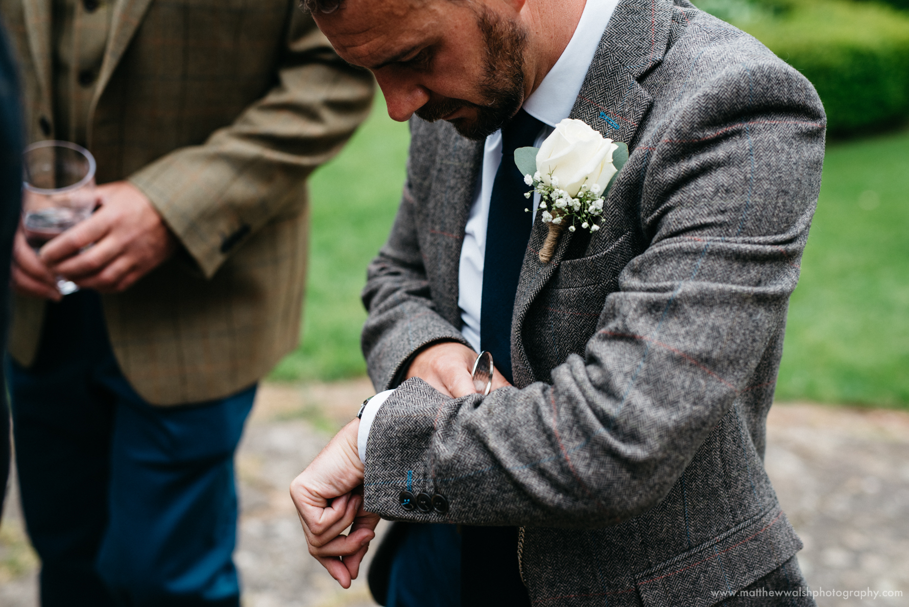 Groom checking his watch, not for the first time