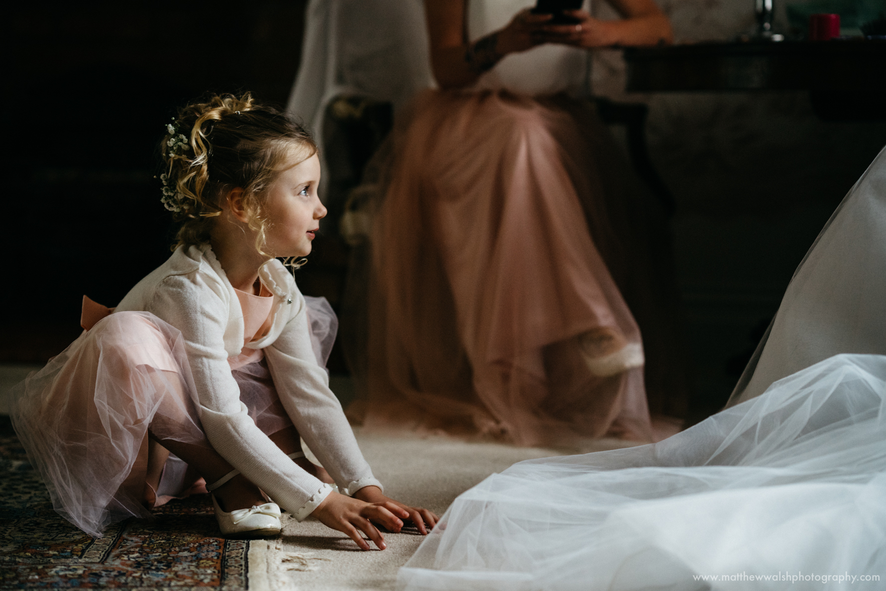 Flower girl awaits the bride for the ceremony