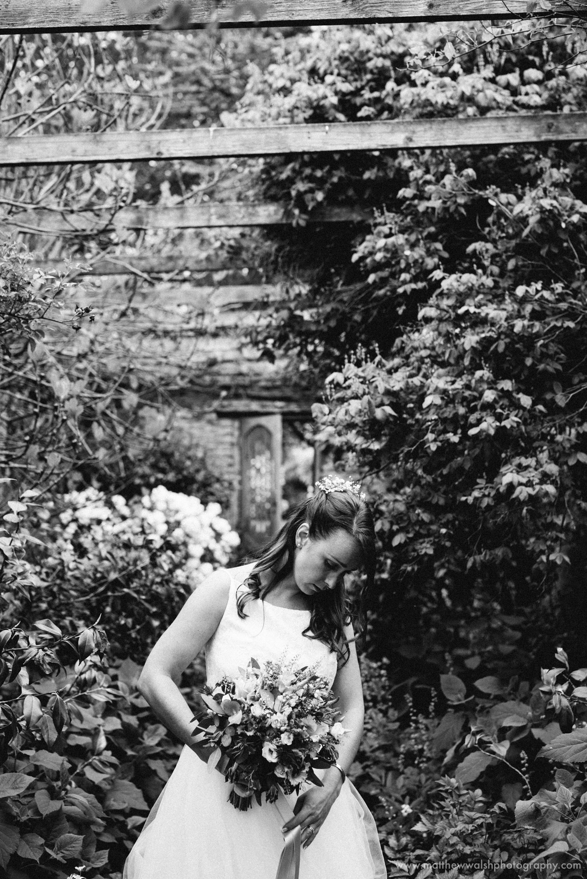 The bride looking gorgeous in the beautiful gardens of the venue