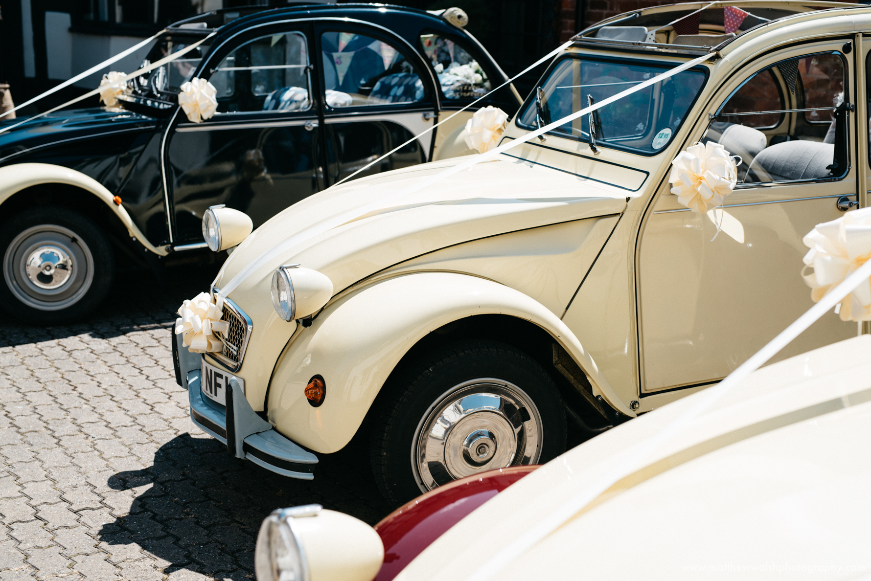 2cv Wedding cars ready to take the bridal party to the church