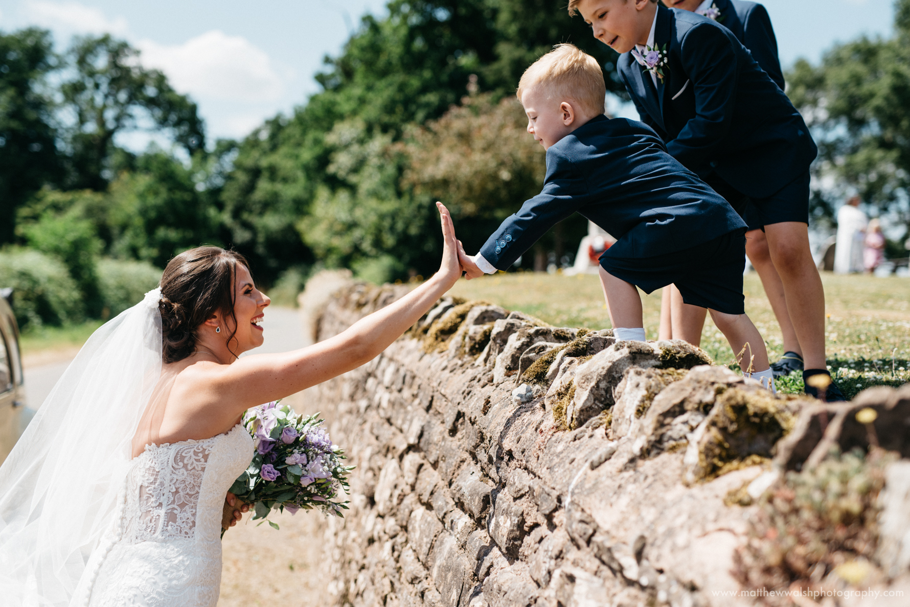 High 5 time for the bride and little boy