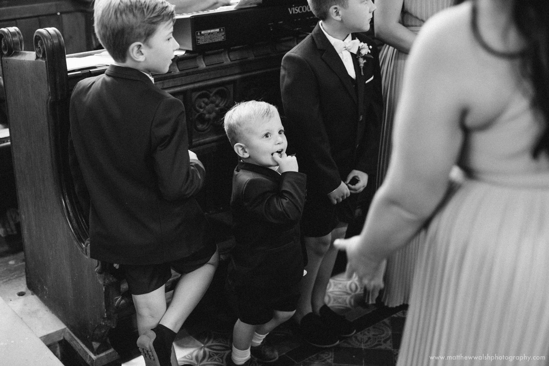 Image of a cute little page boy having fun during the ceremony