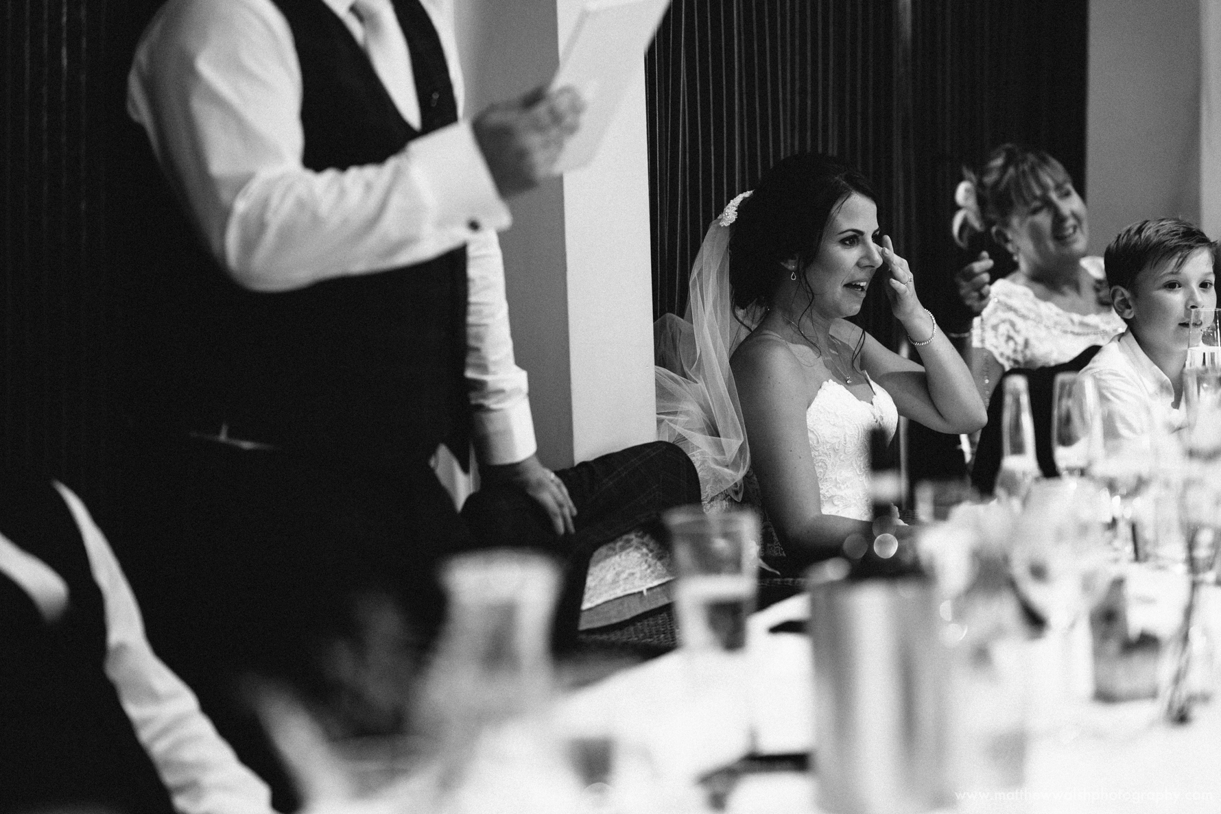 A hilarious moment makes the bride shed a tear
