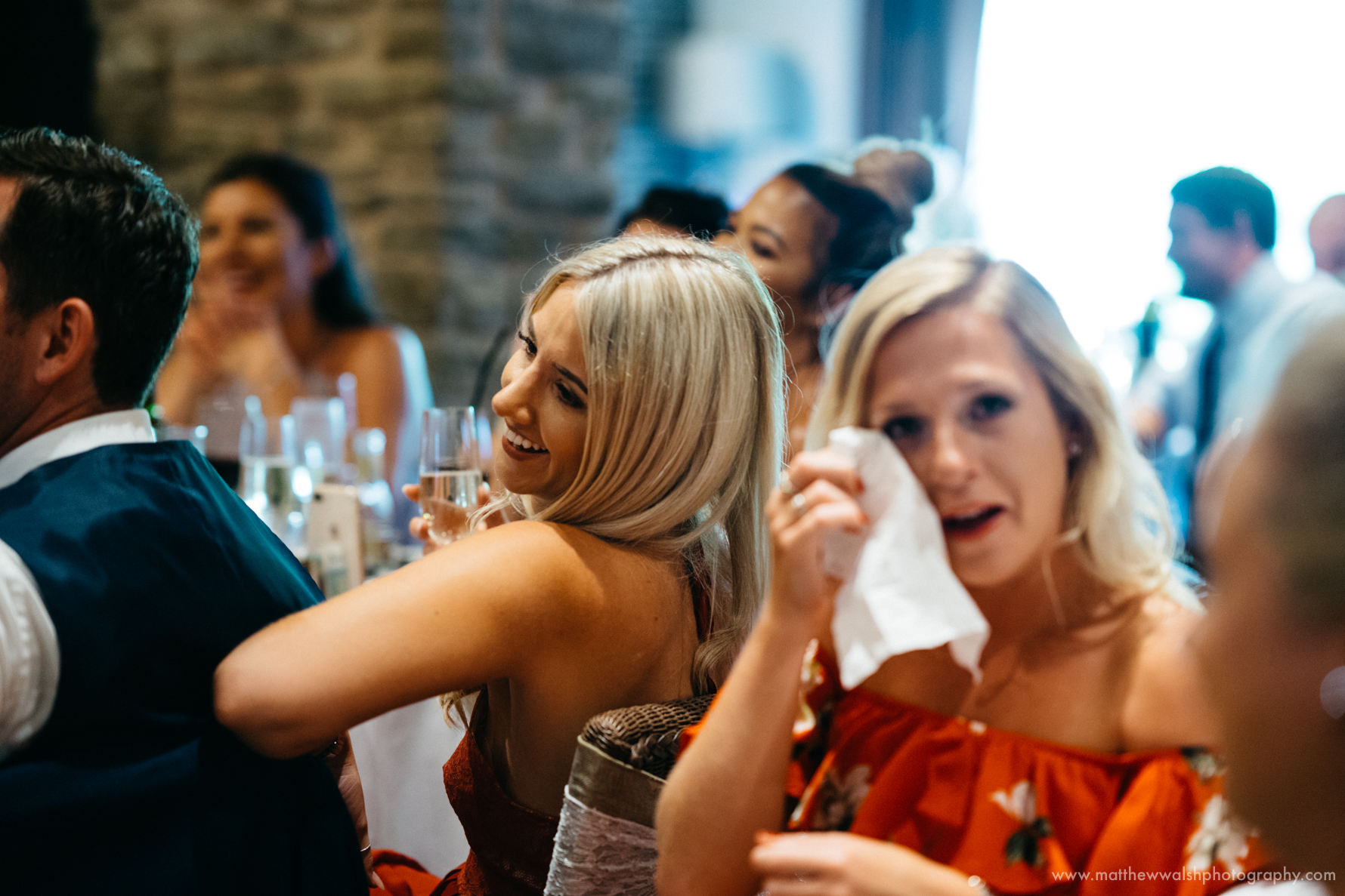 Guests laughing at the funny but intimate speeches