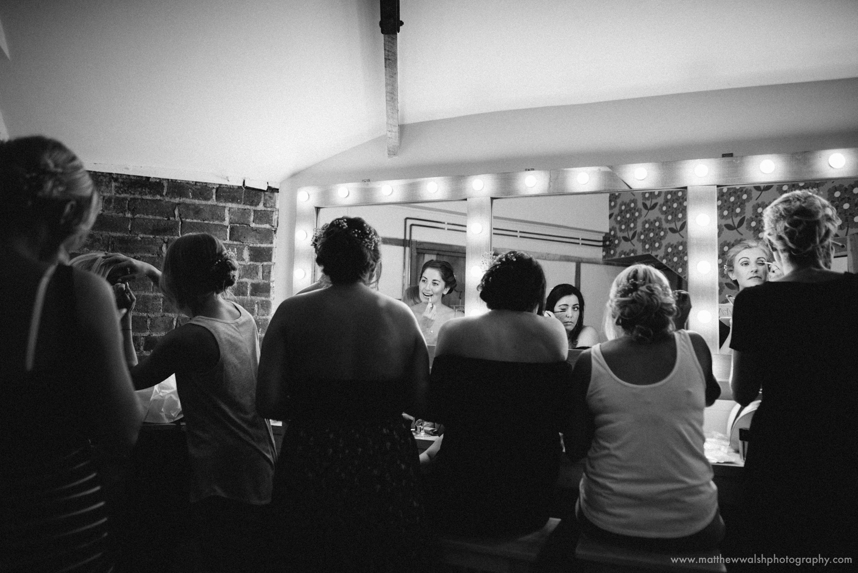Bridal party putting their makeup on in the girls make up room