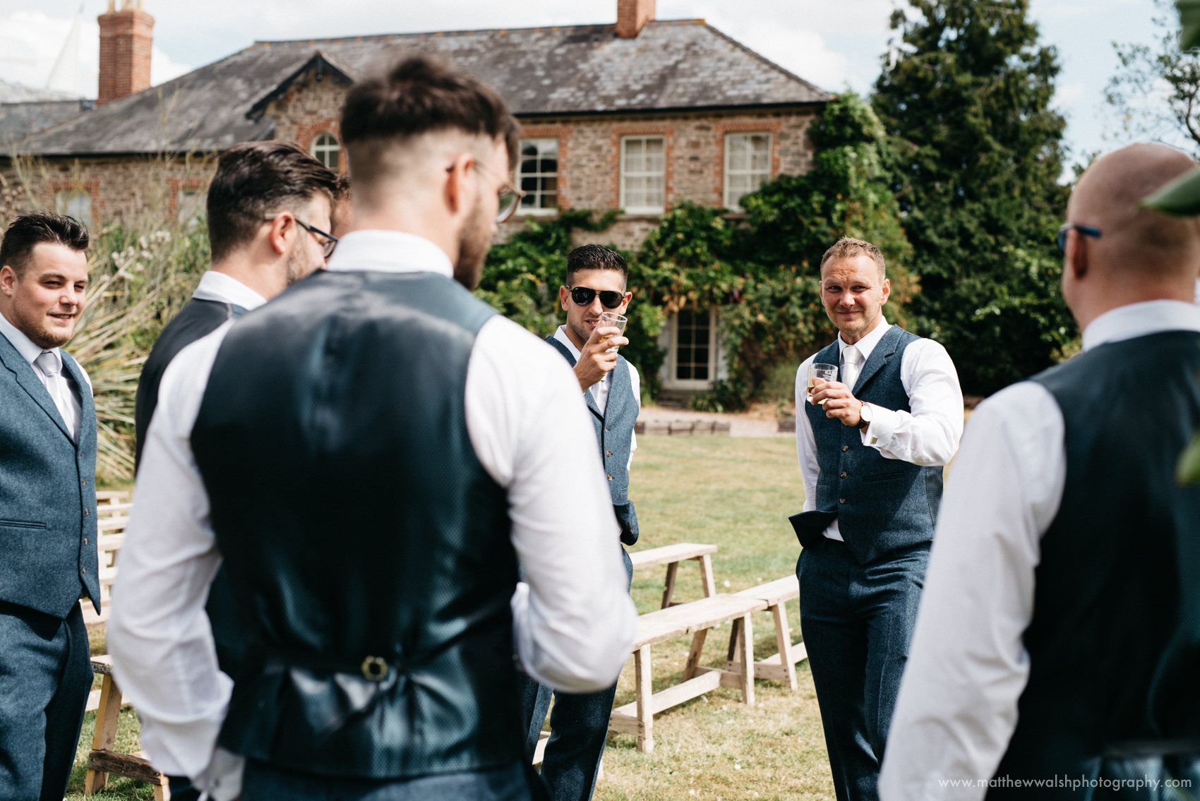 Groomsmen having a little pre ceremony banter with the groom