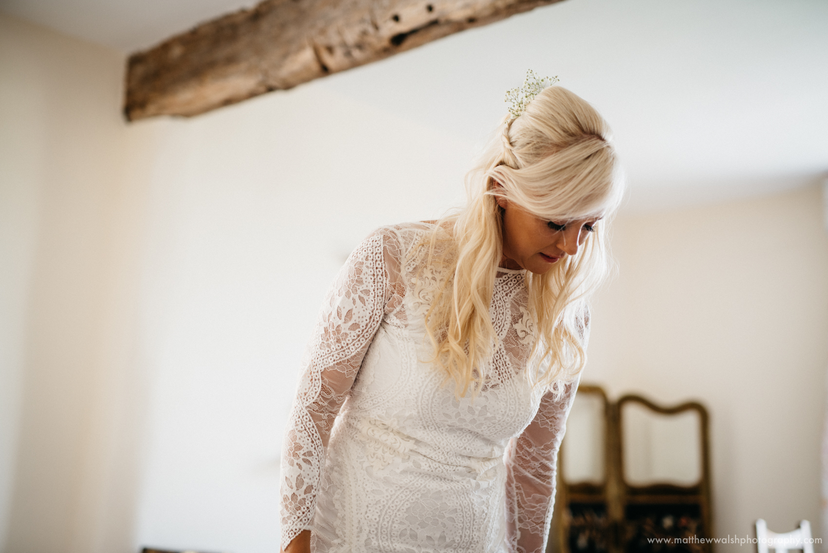 The bride looking elegant in her beautiful lace wedding dress
