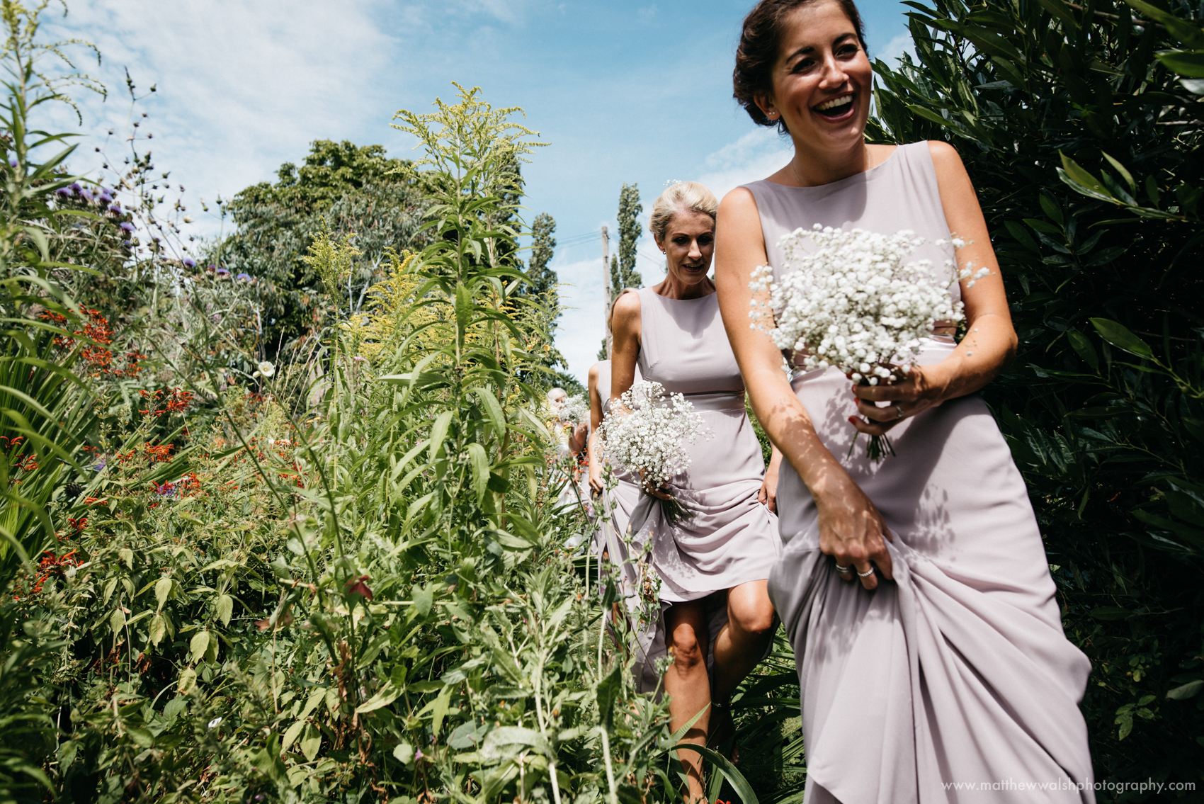A bit of an adventure as the bridal party fight their way through the flowers