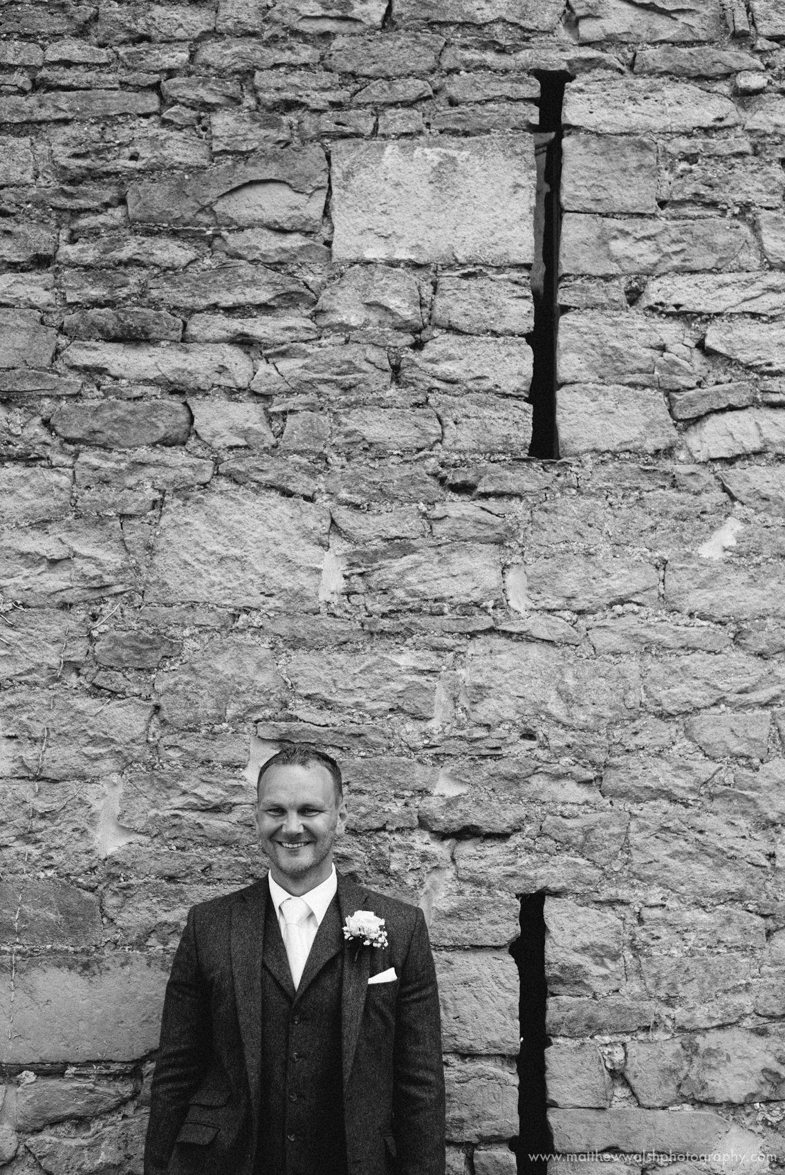 A favourite negative space portrait of the groom