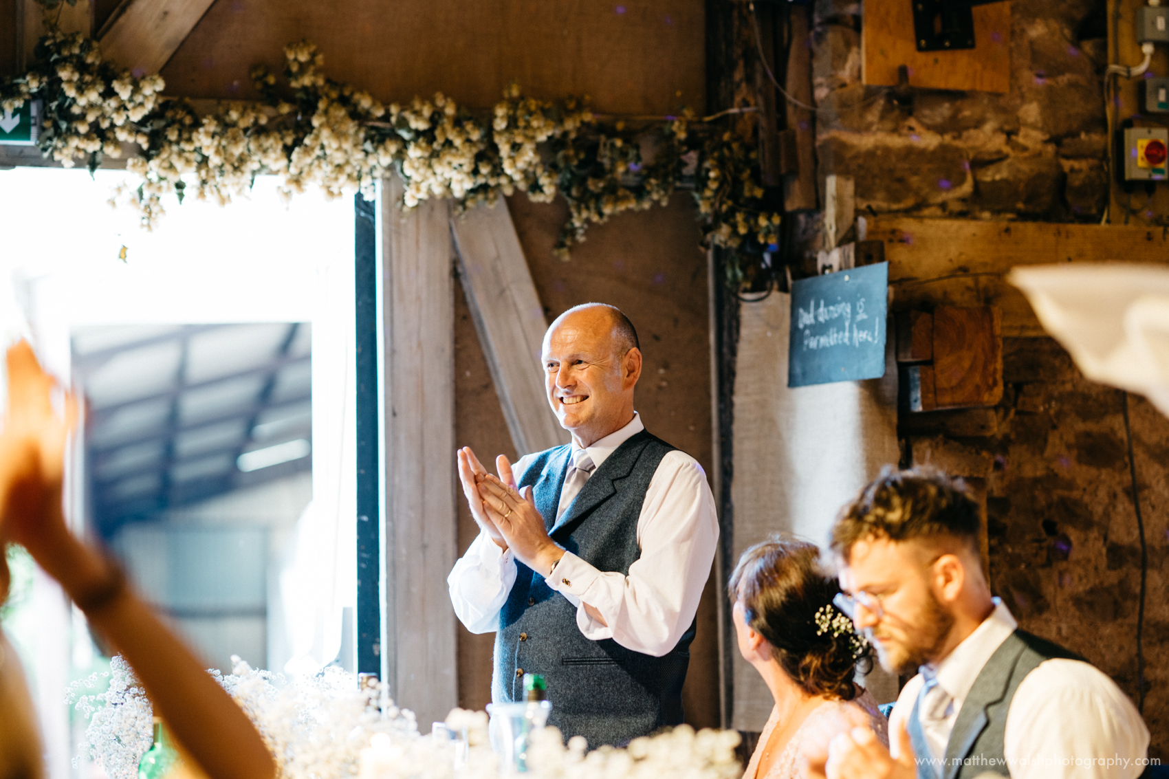 Father of the bride claps the speeches