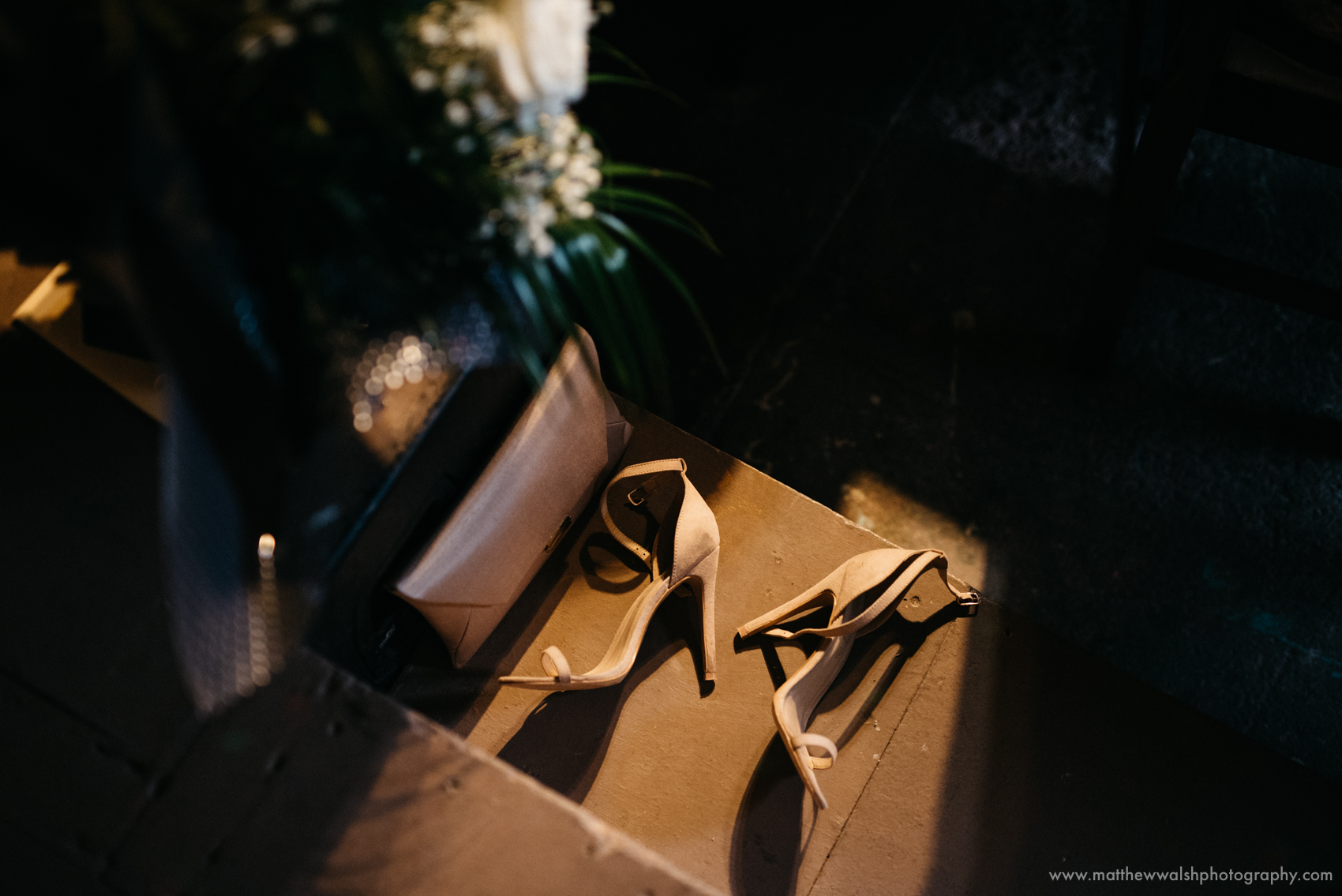 A detail of the brides shoes left on a step
