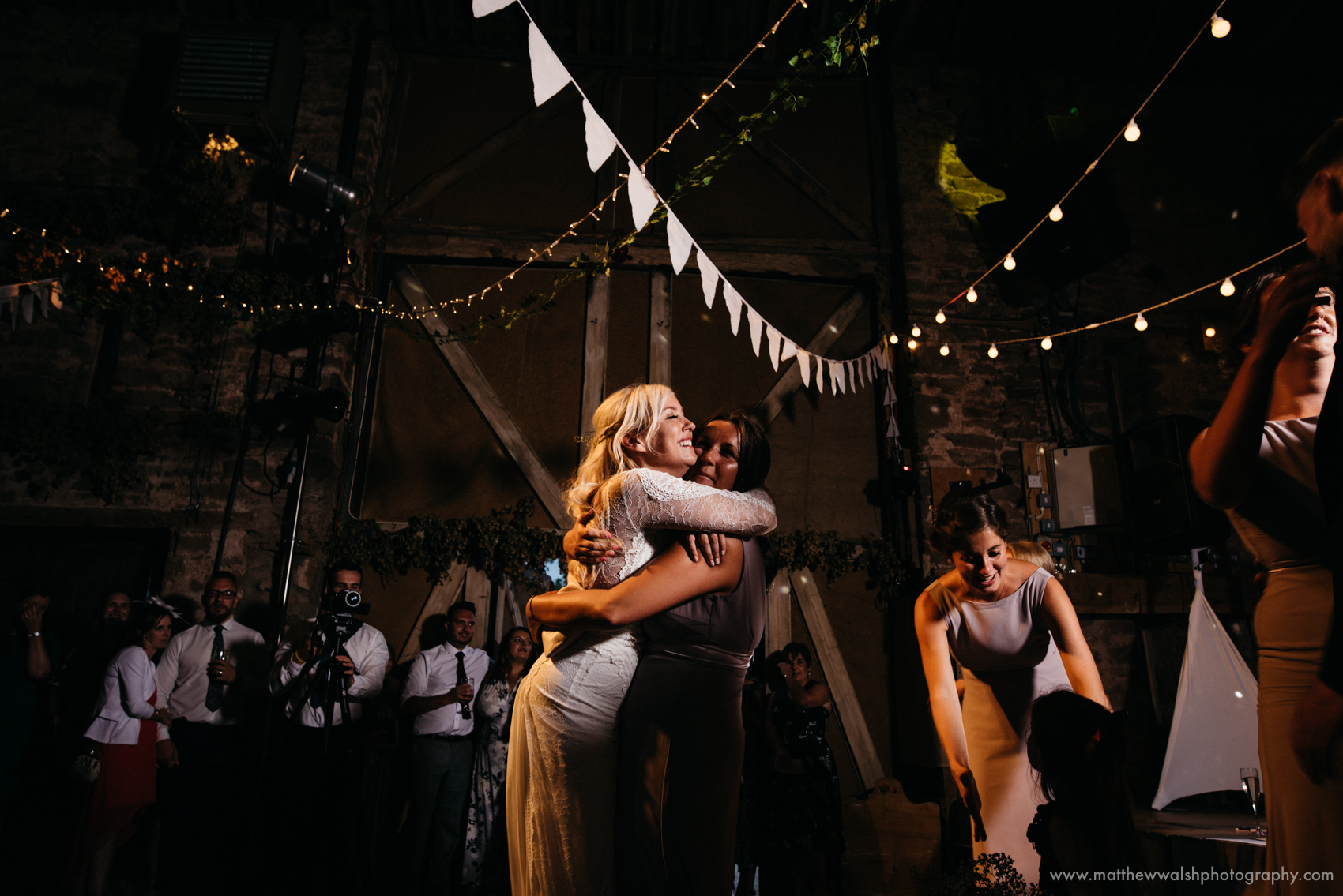 An excited friend hugs and congratulates the bride