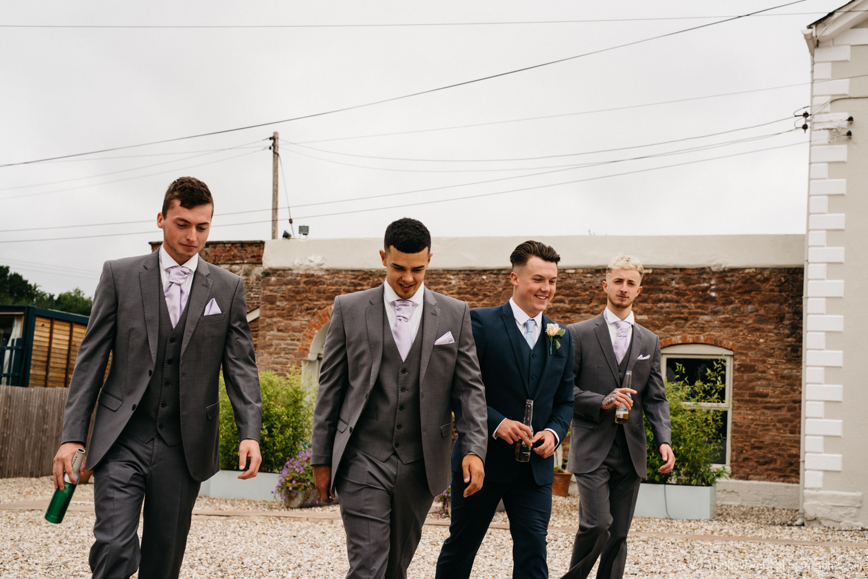 Groomsmen walking and all looking dapper and feeling good