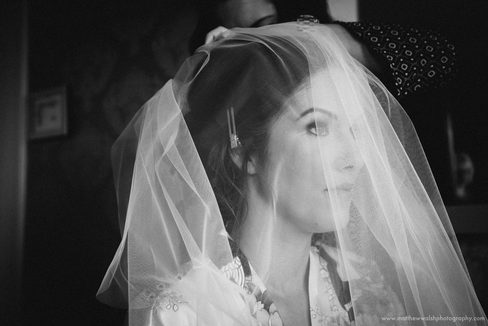 The bride with the veil over her face and looking fantastic