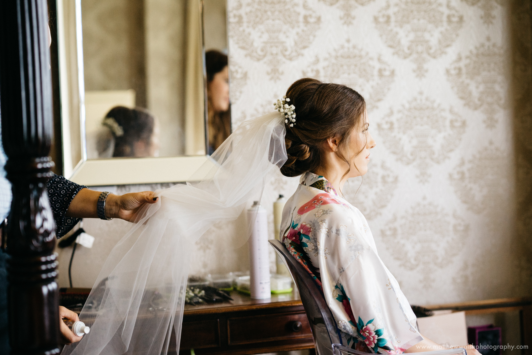 The bride and the hair dresser make the final preparations