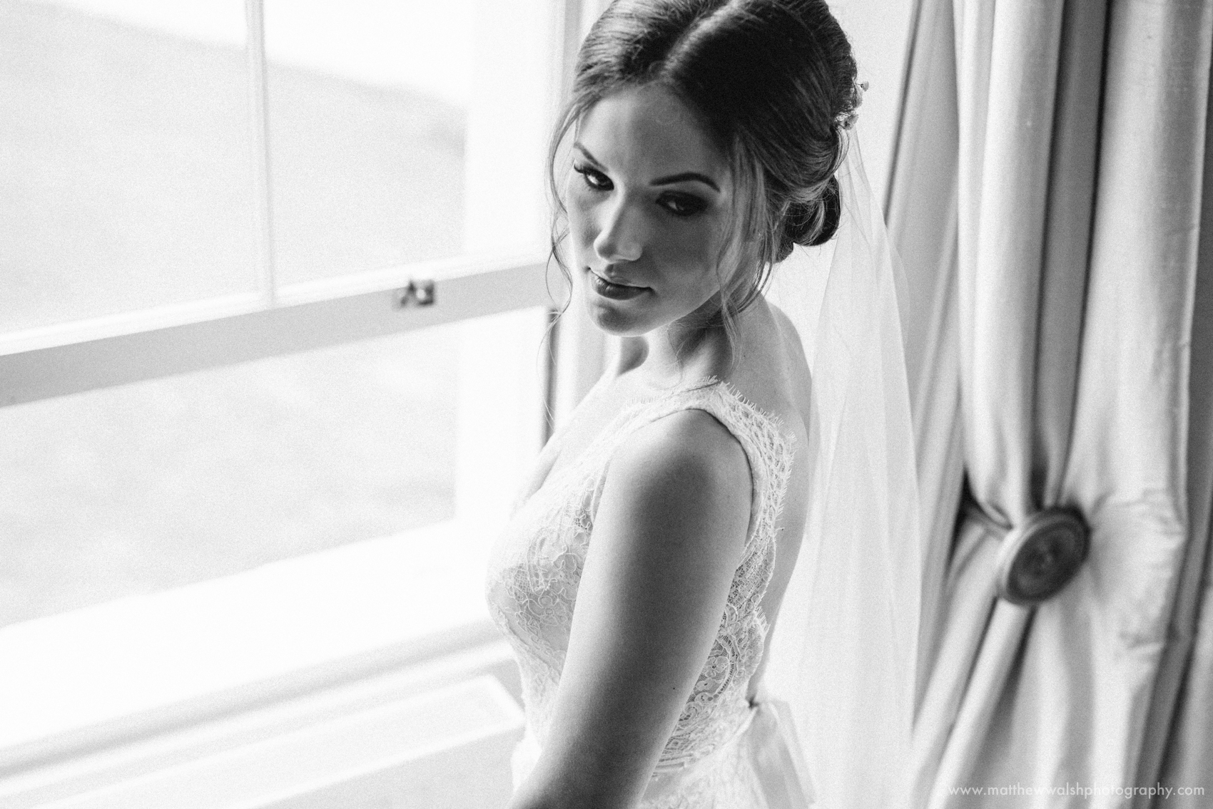 The bride looking stunning as she looks back over her shoulder