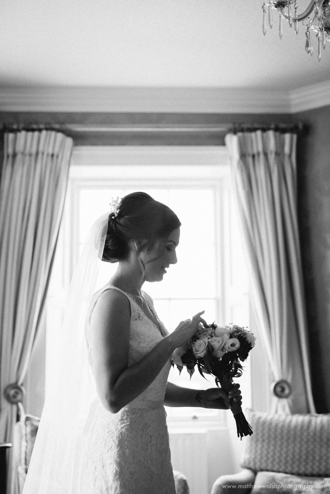 The bride checks the flowers in her bouquet