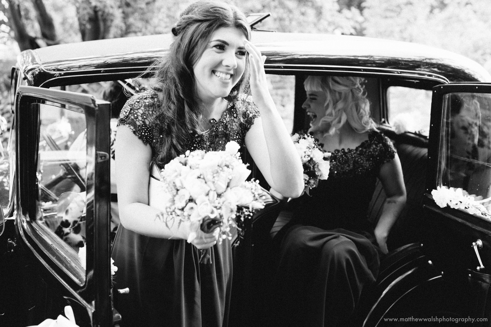 Bridesmaids having some laughs as the get out of the car
