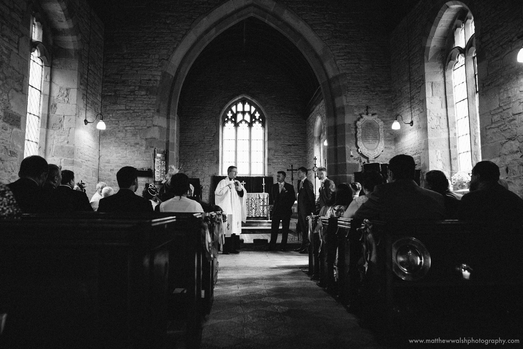 The Vicar speaks to the gathered Groom and guests, please turn phones off and no photographer during the ceremony, there will be an opportunity at the end for photographs.