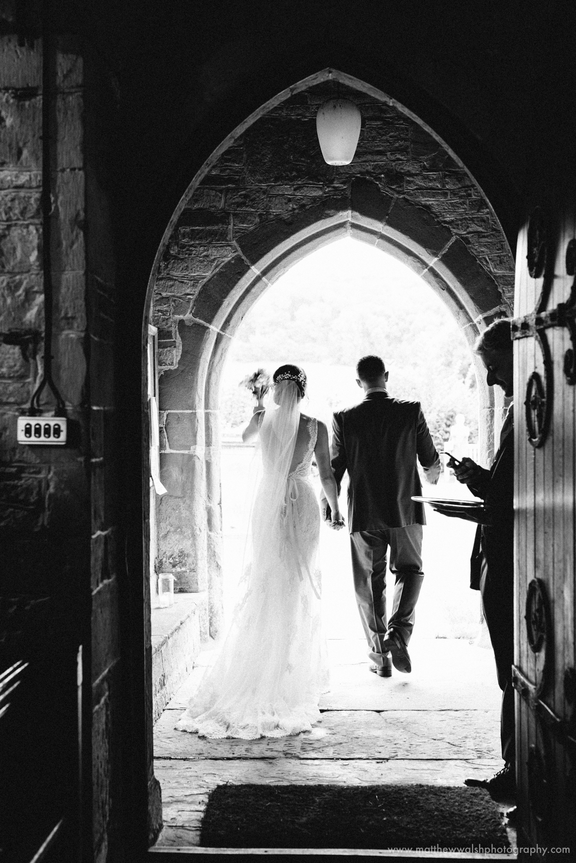 The cutest moment as the bride and groom set out from the church to embark on a new married adventure