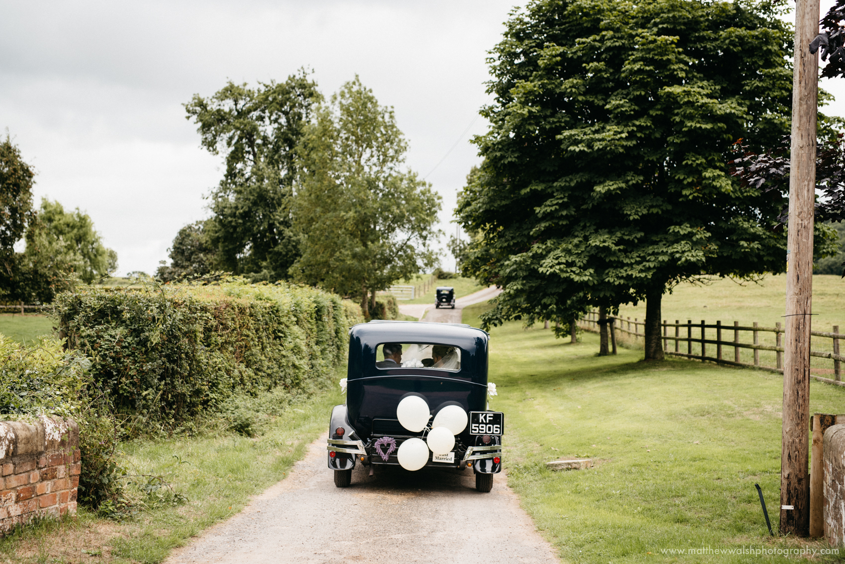 Wedding cars setting off from the church to the reception venue, a story telling moment to create a transition between venues