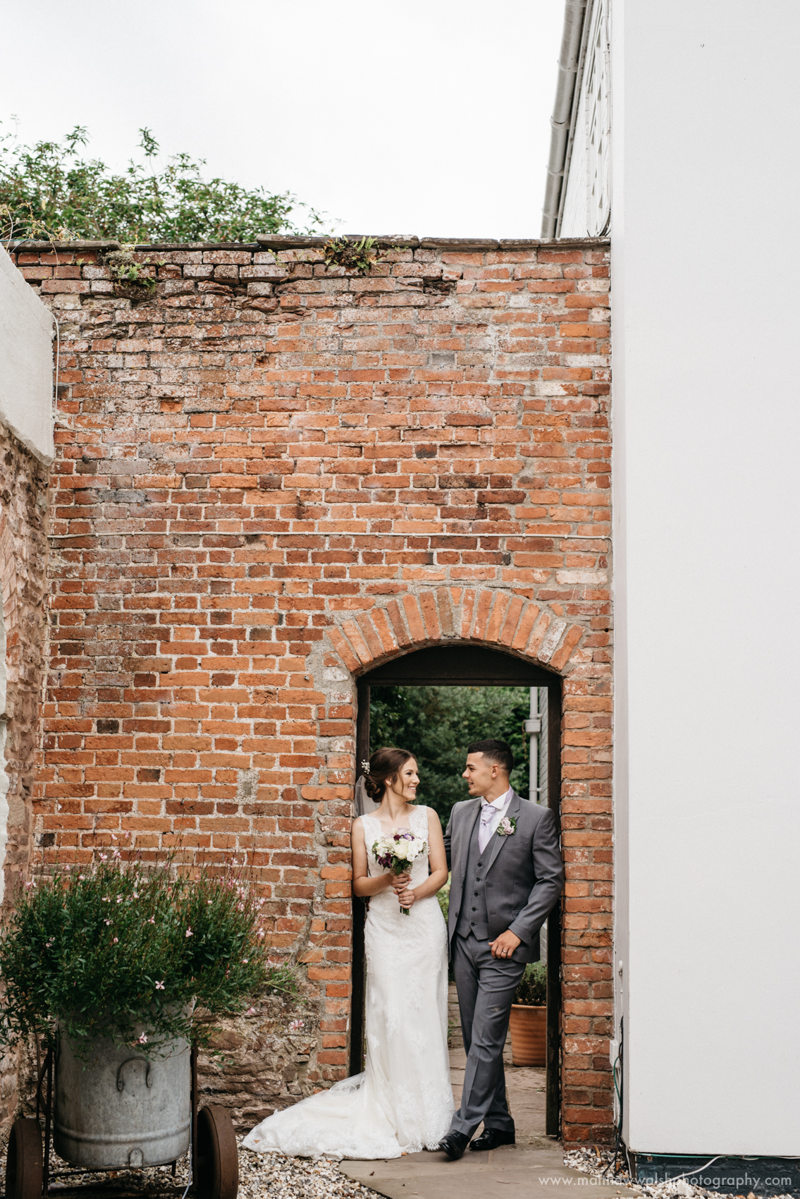 The newlyweds standing in a doorway
