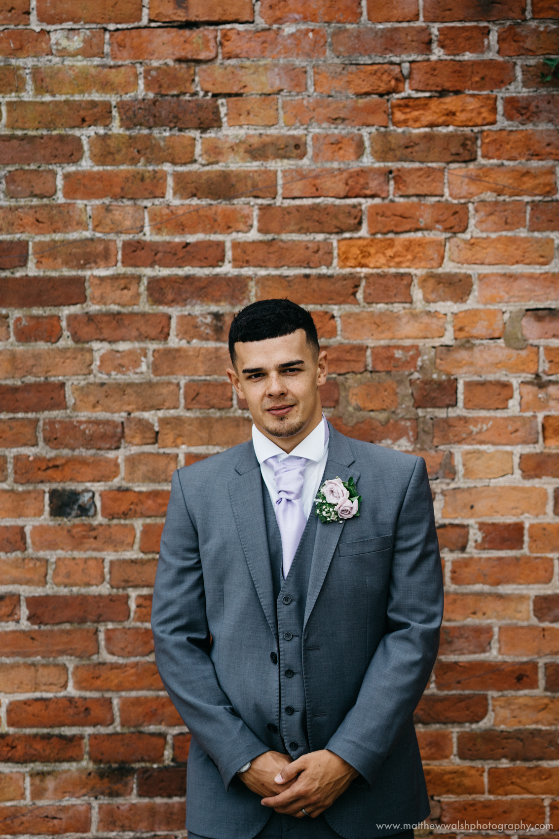 A portrait of the groom on his wedding day