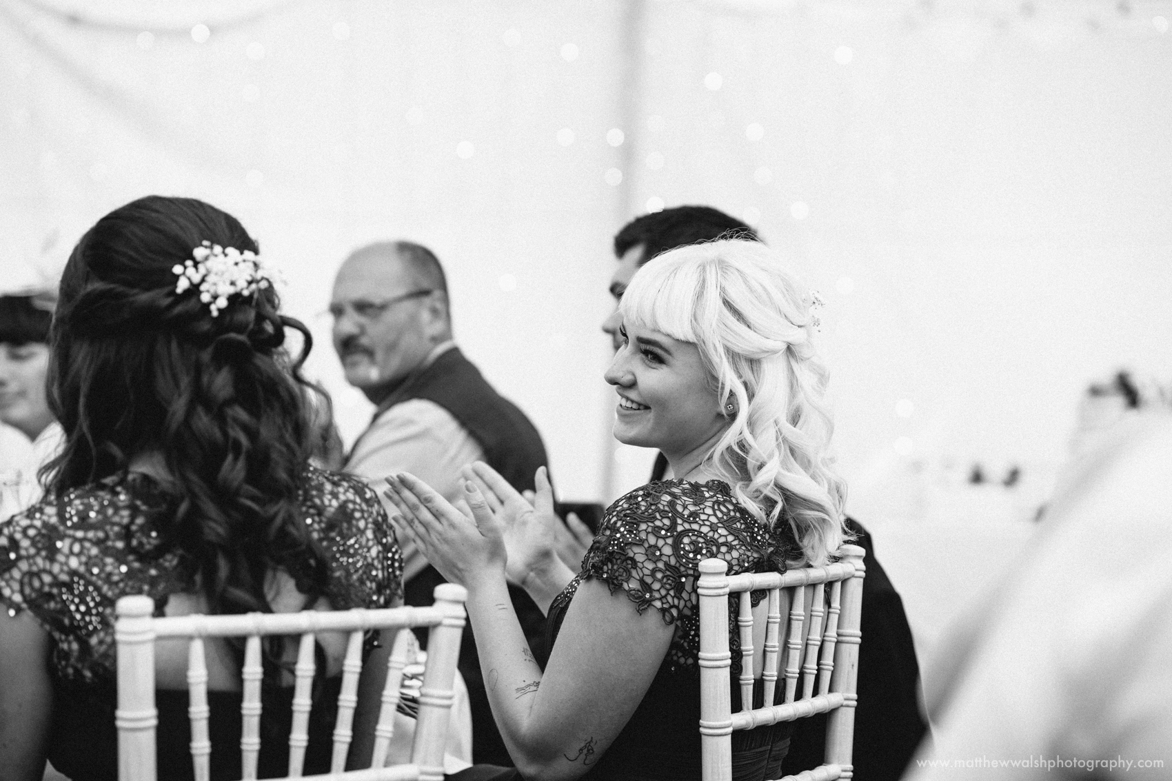 Bridesmaid laughs at the grooms speech