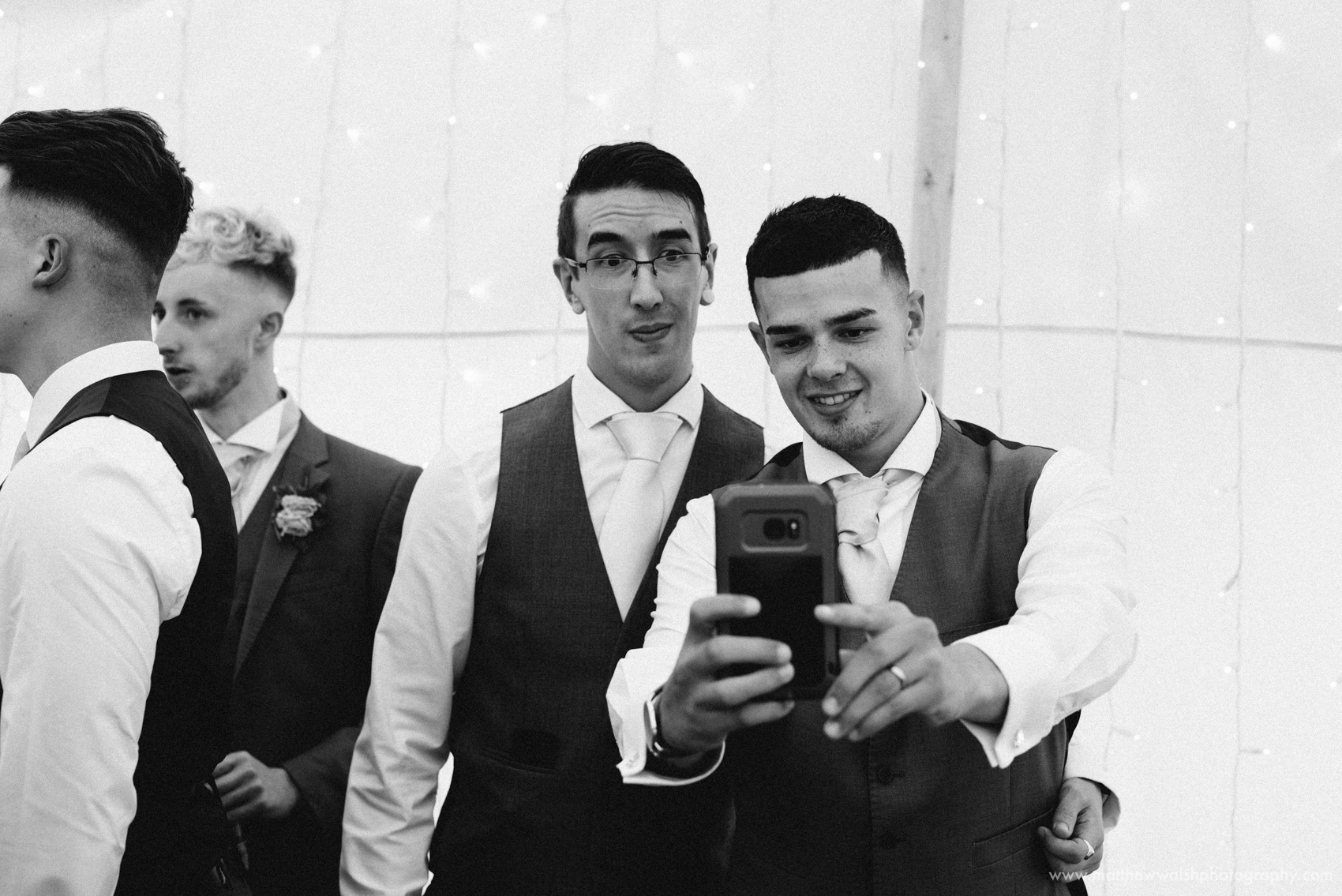 The groom and his brother take a selfie