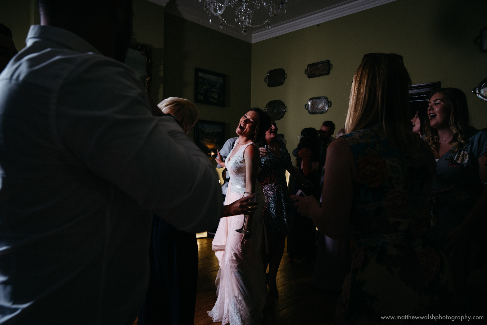 A very happy bride dancing