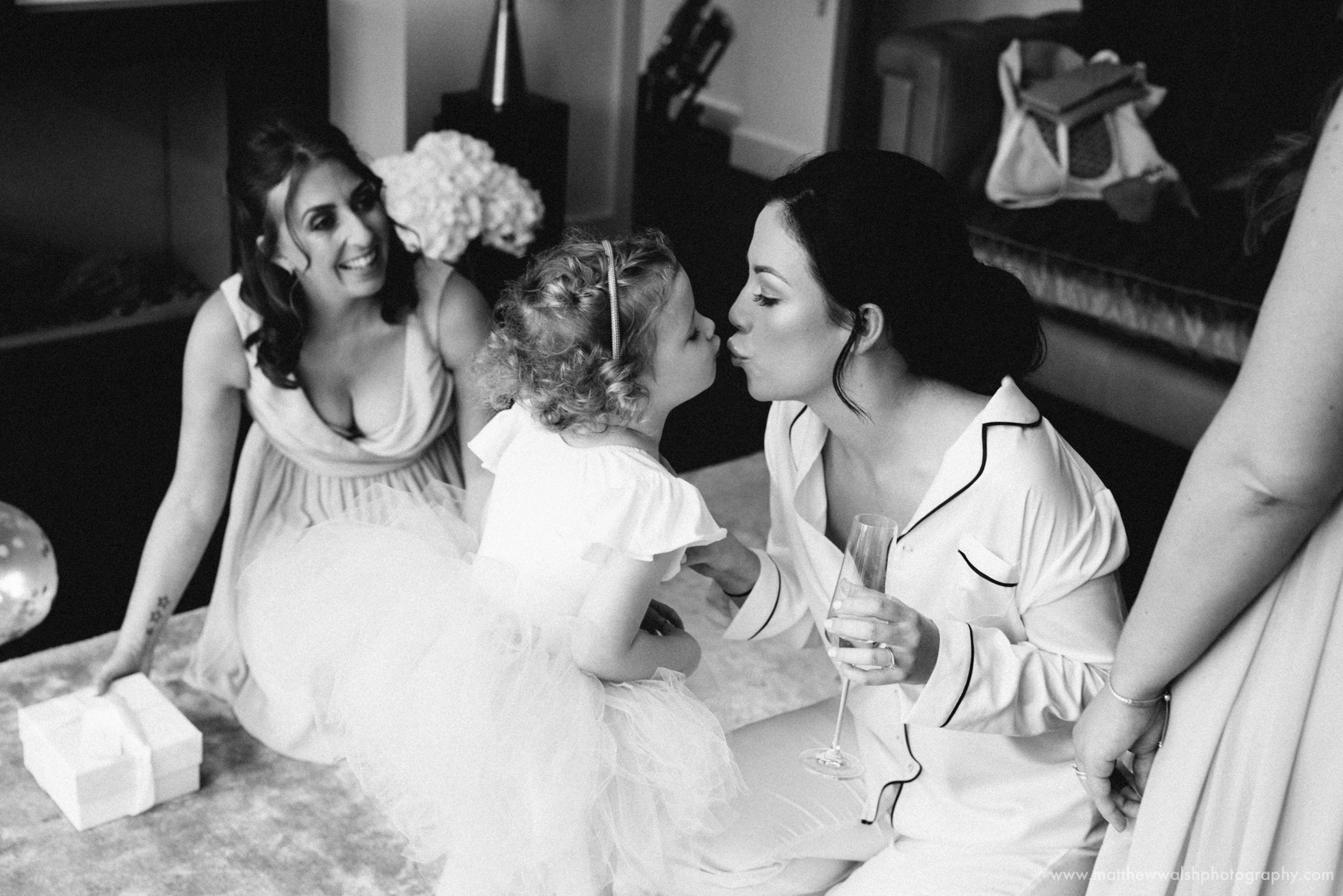 Another intimate moment as the bride and little daughter prepare for the day ahead