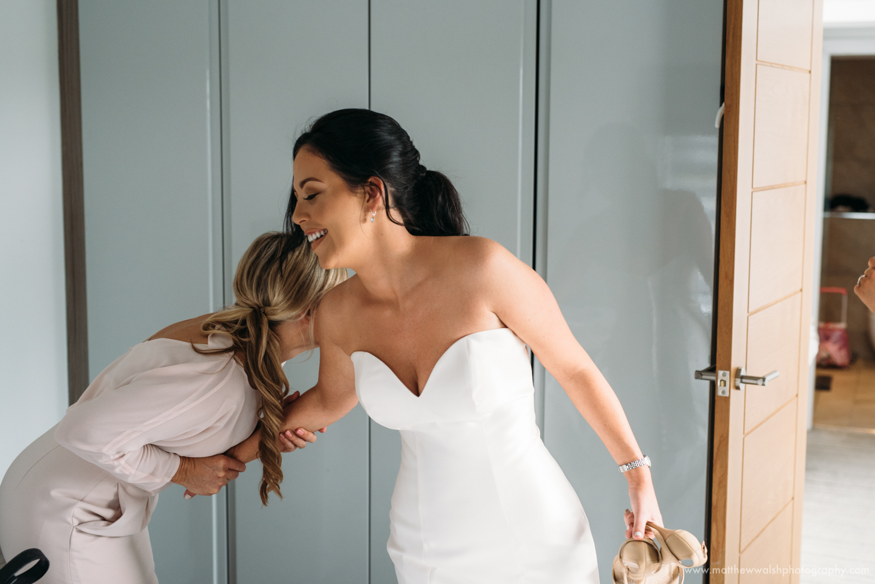 A personal and emotional moment between the mother of the bride holds onto her daughter