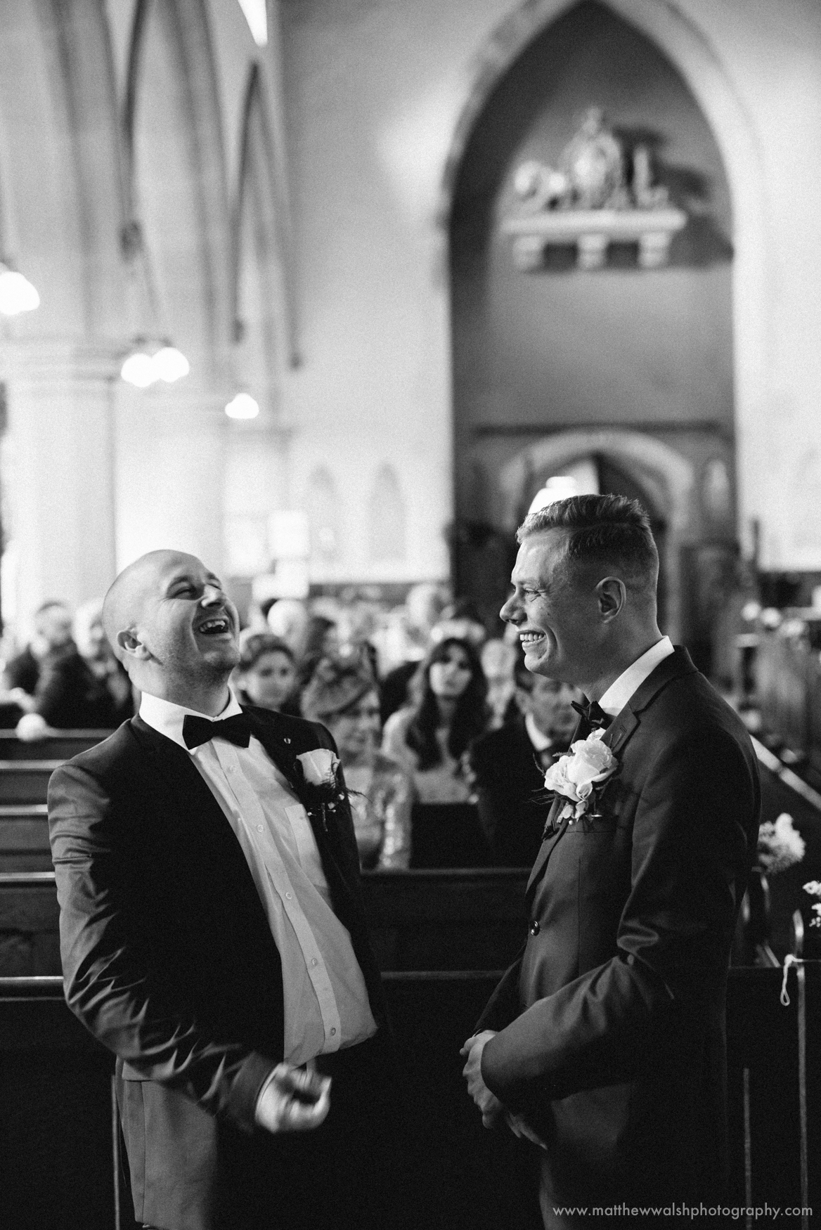The groom and his best man await the bride at the church, also looking relaxed but with perhaps a few hidden nerves