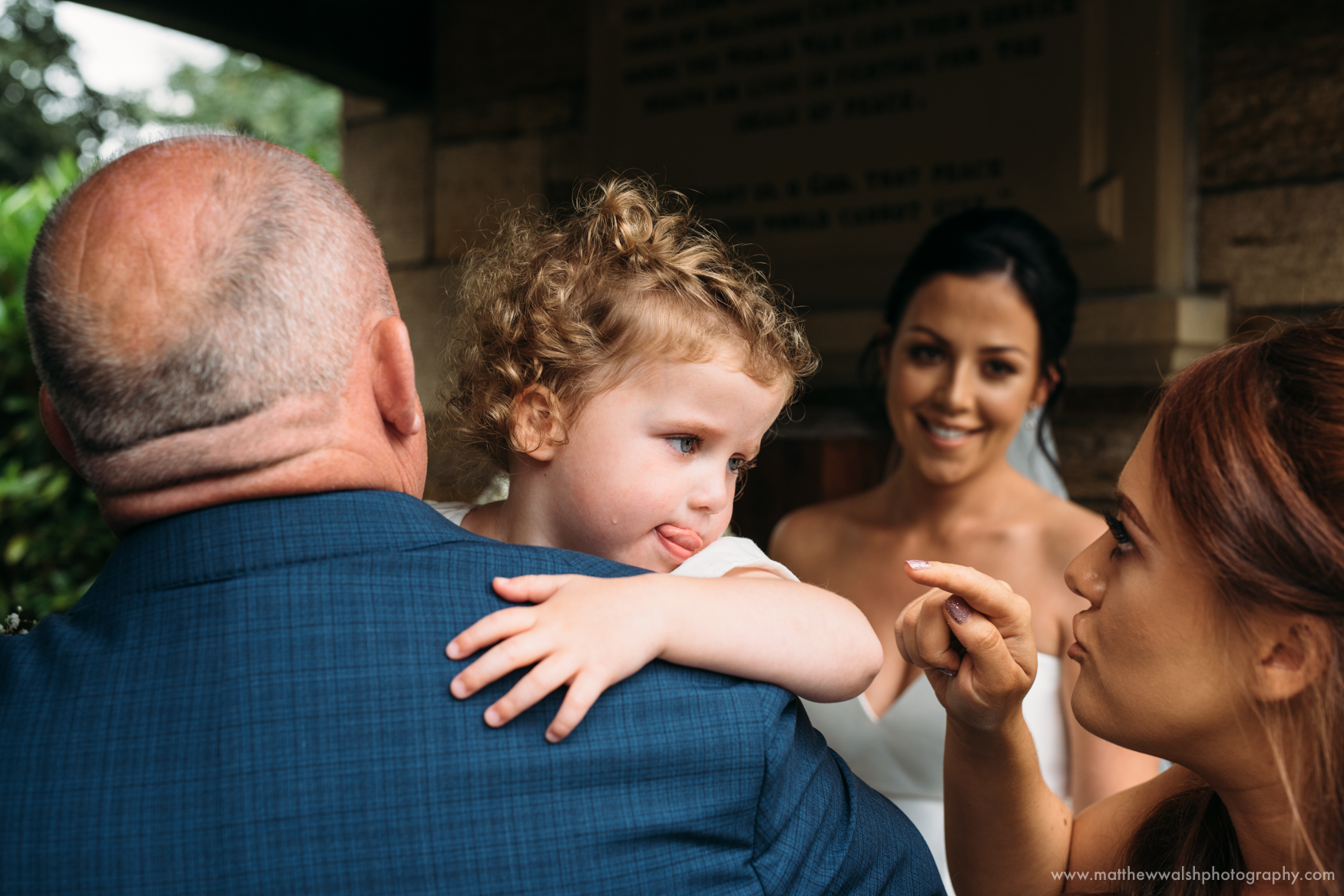 The flower girl has a little cry but her grandfather gives her a hug