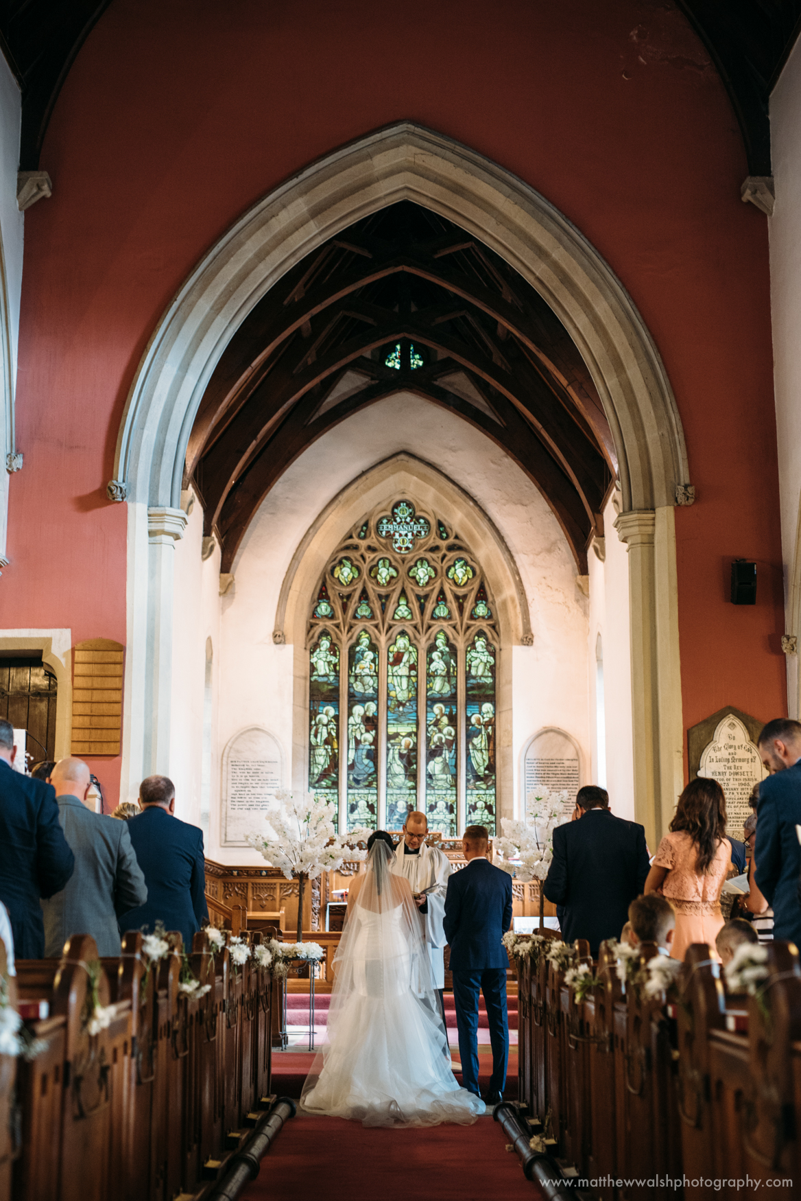 A wide angle view of the Church as the Bride and groom marry