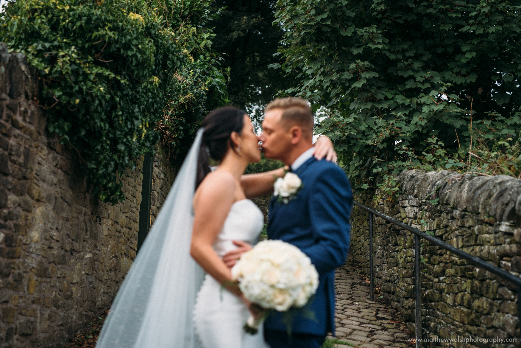 Capturing a personal moment as the bride and groom kiss