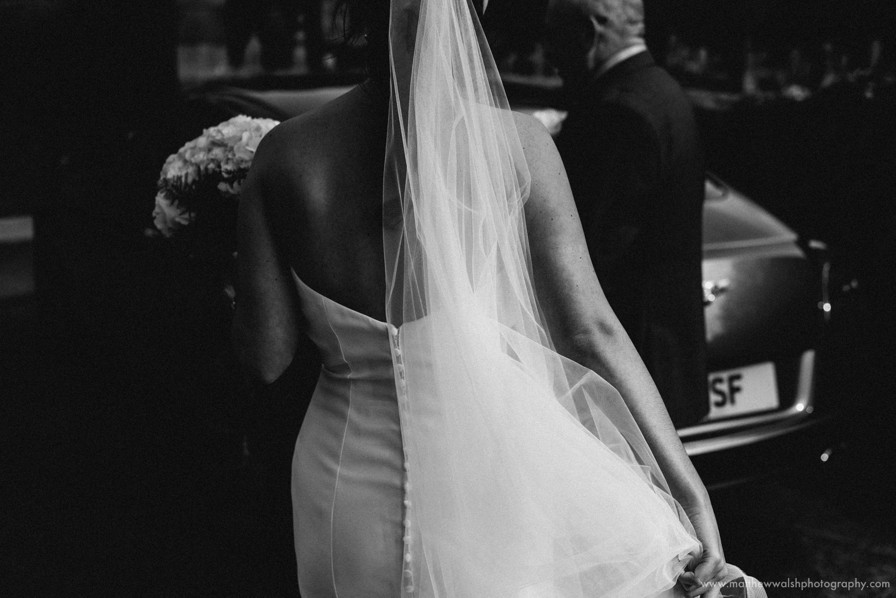 Back detail of the brides beautiful wedding dress