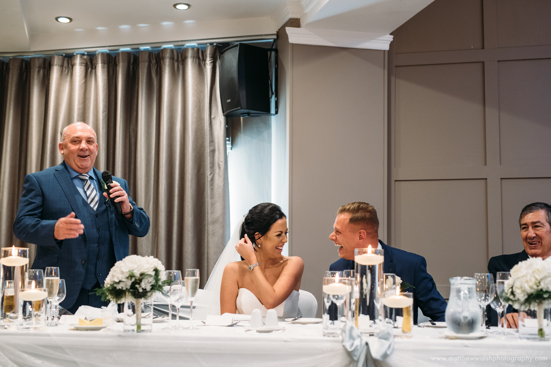 Father of the bride tells a joke as he makes his speech at the Red Hall hotel Bury