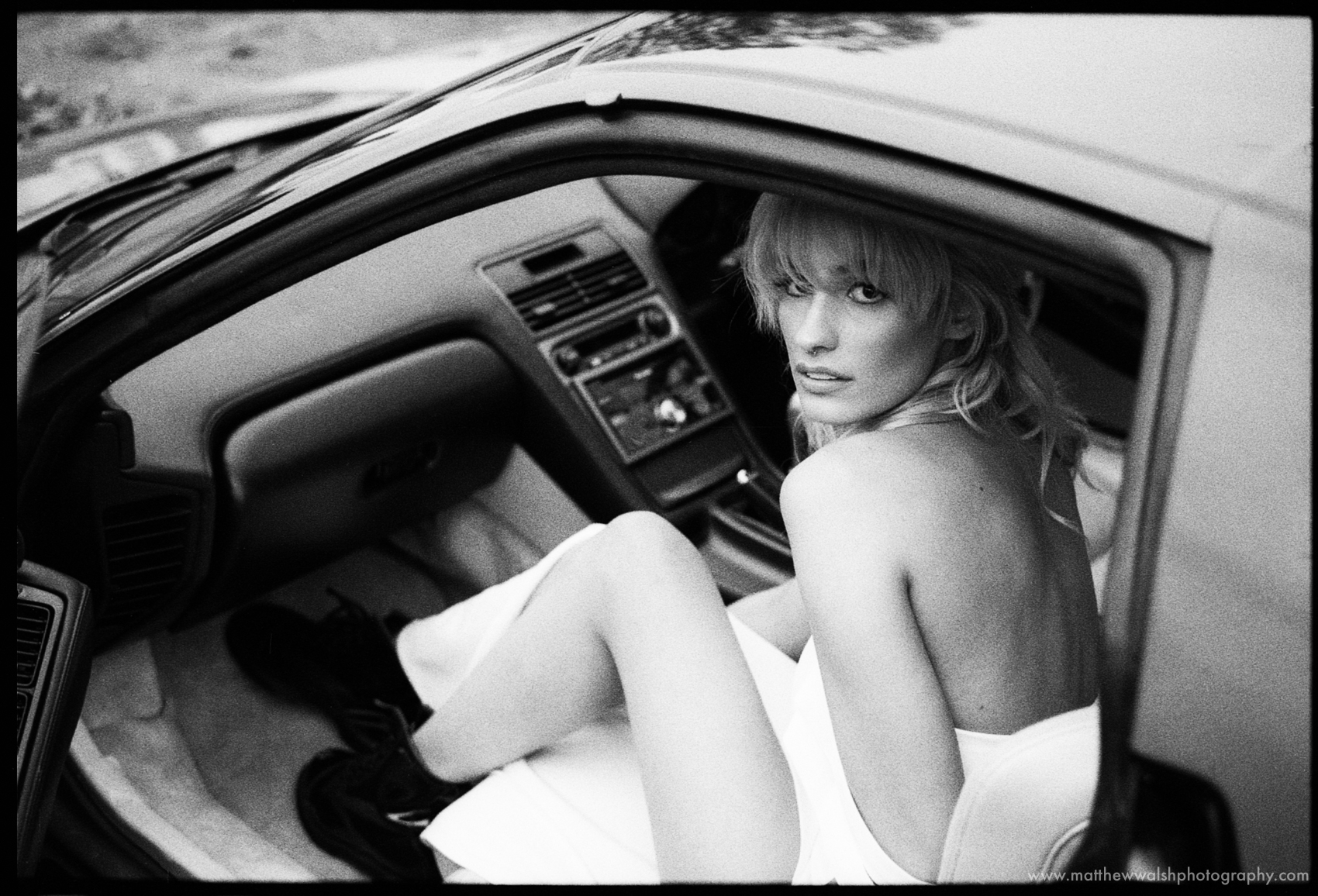 Looking sexy in a car in b&w shot on the Leica