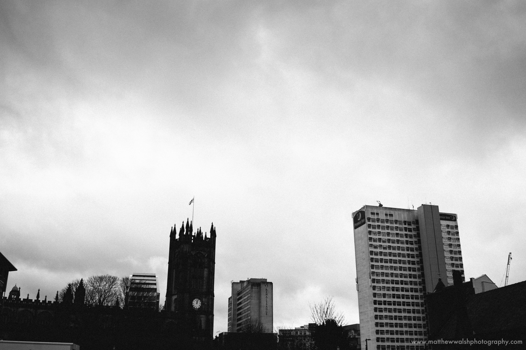 Manchester skyline on a gloomy January day adding context to the story of the day