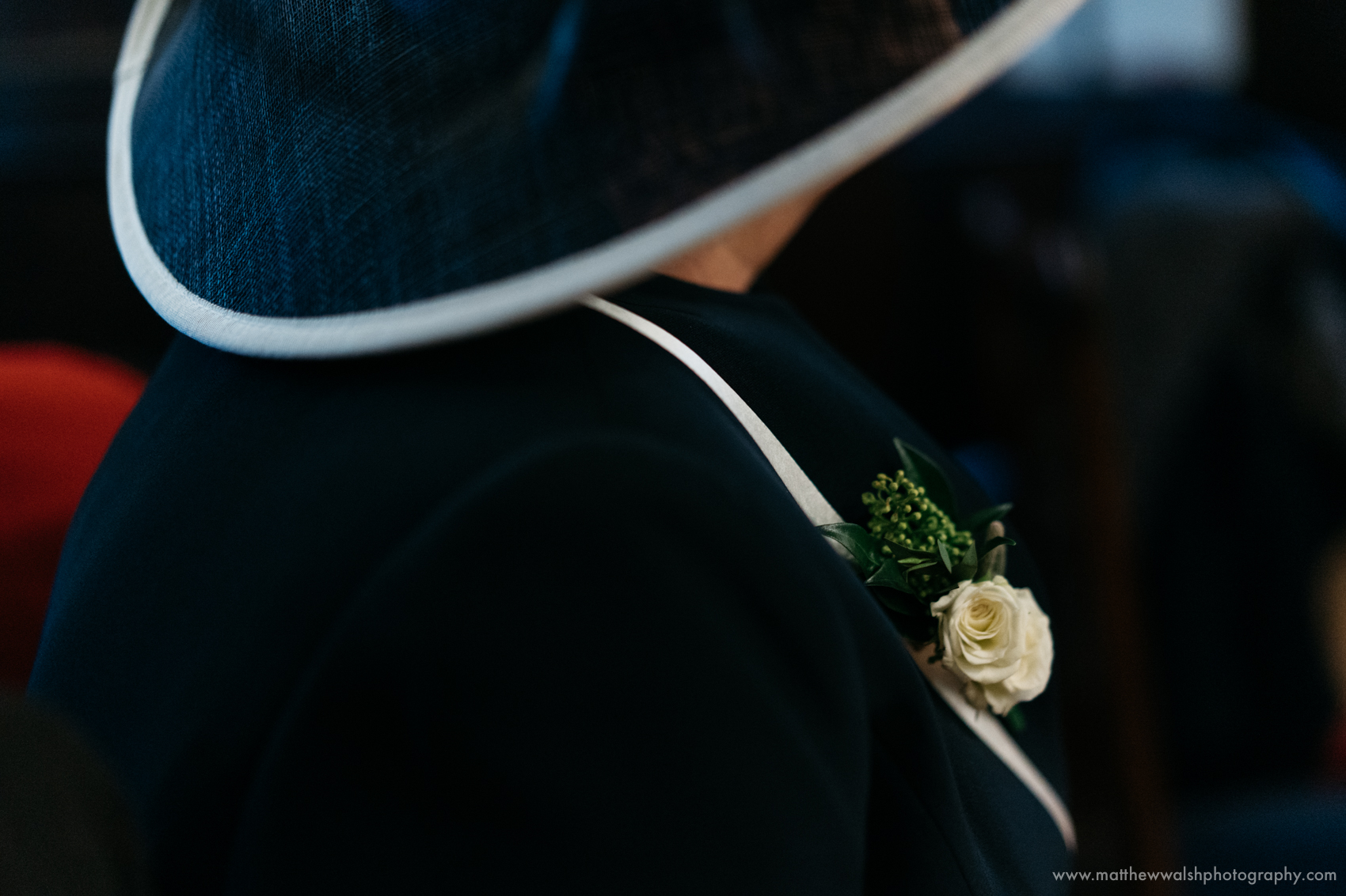 Curves and shapes with a floral detail, just a little observation of the mother of the brides hat