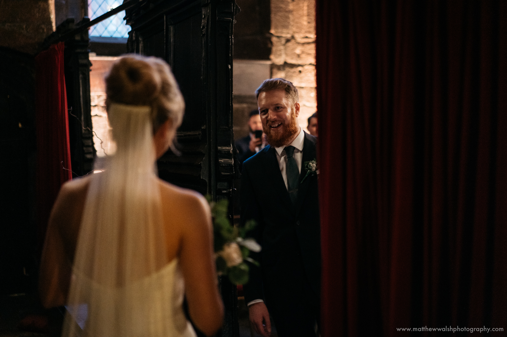 The bride and groom seeing each other for the first time